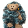 Teddy bear with flu sick thermometer wrapped in a blue blanket — Stockfoto