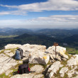 Backpacks on top of a mountain and valley views, Sierra Salvada, Spain — Stockfoto