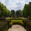 Stock Photo: Path surrounded by shrubs and trees, garden of royal palace, Spain