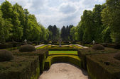 Path surrounded by shrubs and trees, garden of the royal palace, Spain — Stock Photo