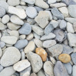 Smooth beach stone background - Stock Photo