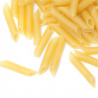 Some raw penne macaroni isolated on white background — Stock Photo #19414211