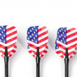 Three target playing darts, whit USA flag colors in the feather, isolated - Stock Photo