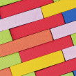 Wooden colorful blocks, aligned. Textured background - Stock Photo