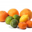 Oranges, limes, tangerines and lemon, isolated on white - Stock Photo