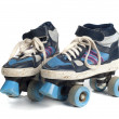 Old blue rollerblades isolated on white background — Stock Photo #22276291