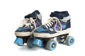 Old blue rollerblades isolated on white background — Stock Photo