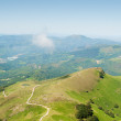 Mountains and green pastures seen from above — Stock Photo