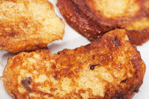Some torrijas on a plate. torrijas or toast is a typical sweet of the celebrations of Lent and Holy Week in Spain — Stock Photo