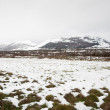 Fields and mountains covered by the snow — Stock Photo