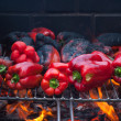 Red peppers roasting on barbecue — Stock Photo #34779127