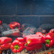 Red peppers roasting on barbecue — Stock Photo #34779169