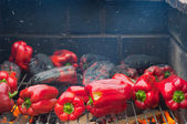 Red peppers roasting on the barbecue — Stock Photo
