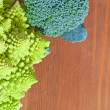 Raw broccoli and romanescu vegetables, on wooden background — Stock Photo