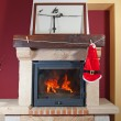 Fireplace at christmas. santsuit hanging — Stock Photo #36051039