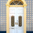 Beautiful antique door in decorated facade — Stock Photo #38421249