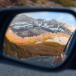 Snowy landscape in car rearview — Stock Photo #38424799
