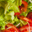 Fresh lettuce and tomato salad in the table, ready to meal — Stock Photo