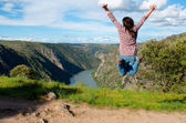 Young woman jumping. Arribes del Duero river natural park — Foto Stock
