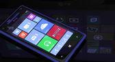 Windows Phone 8 with Windows 8 reflection — Stock Photo