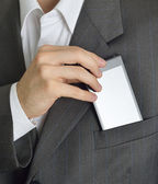Executive saving or taking your phone in the jacket — Stock Photo