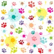 Colored pattern with paw prints and blots — Stock Vector #21292675