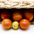 Fresh tomatoes in the basket - Stock Photo