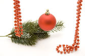 Christmas ball with bead chain — Stock Photo