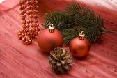 Christmas ball with pine plug — Stock Photo