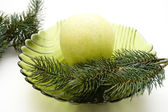 Fir branch and apple — Stock Photo