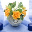 Stock Photo: Candles with flowers vase