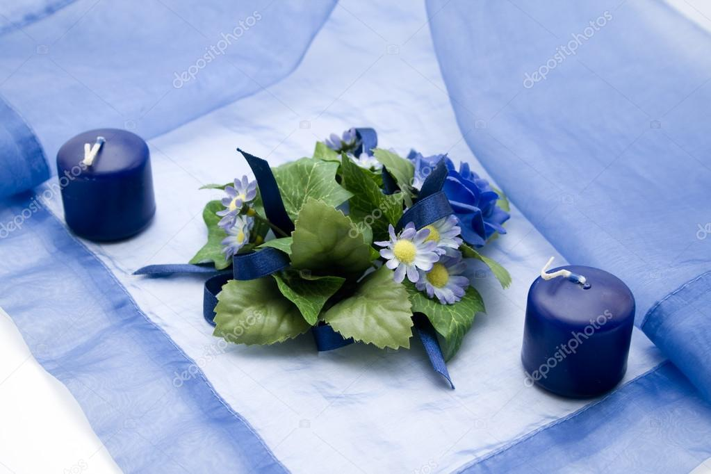 Nice candles on tablecloth with flower — Stock Photo #13643061