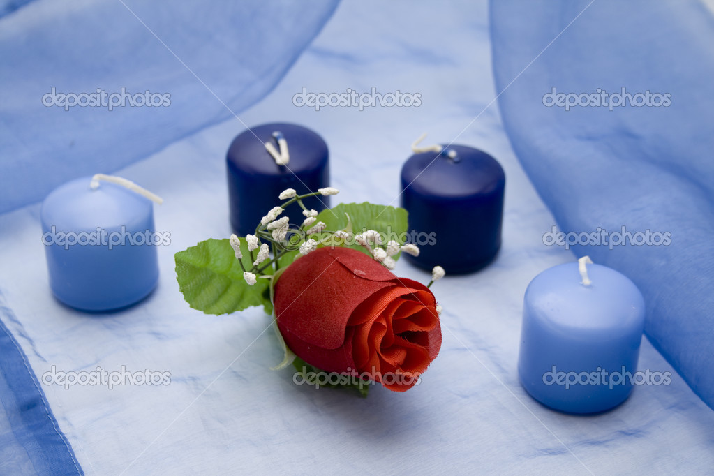 Nice candles on tablecloth with rose — Stock Photo #13643235