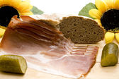 Ham bacon with cucumber — Stock Photo