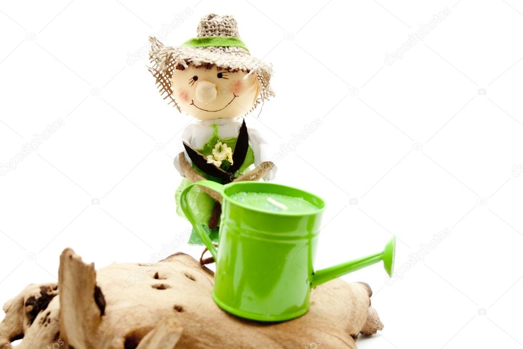 Green watering can with gardener doll   Stock Photo #14821899