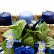 Blue  Candles with flowers — Stock Photo
