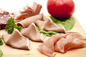 Cold cuts plate with bread — Stock Photo