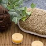 Massage sponge with candle — Stock Photo #15389041