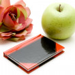 Green apple with notebook — Stock Photo