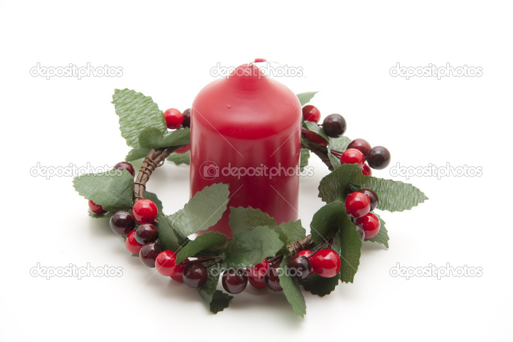 Wax candle in the berry wreath — Stock Photo #15773159