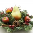 Stock Photo: Pear with Christmas flower arrangement