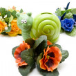 Snail par tin with flowers — Stock Photo