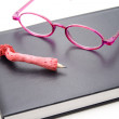 Reading glasses with notebook — Stock Photo