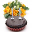 Chocolate cakes with roses — Stock Photo
