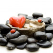 Stones with heart candle — Stock Photo