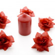 Candle with rose blossoms — Stock Photo