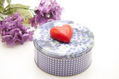Candle with biscuit tin — Stock Photo