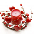 Red candle in the heart wreath - Stock Photo