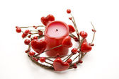Red candle in the heart wreath — Stock Photo