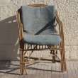 Old rattan armchairs - Stock Photo